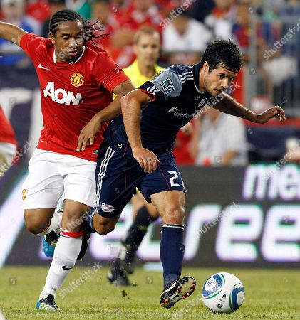Benny Feilhaber, Anderson New England Revolution midfielder Benny Feilhaber (22) controls the ball against Manchester United midfielder Anderson, left, during an exhibition soccer match in Foxborough, Mass. . Manchester United won 4-1