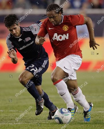Anderson, Benny Feilhaber Manchester United midfielder Anderson takes the ball past New England Revolution midfielder Benny Feilhaber (22) during their exhibition match in Foxborough, Mass., Wednesday night