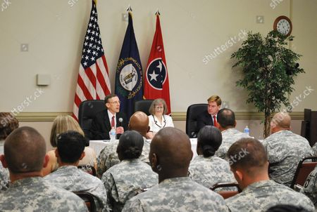 Soldiers at Fort Campbell, Ky., listen during to a discussion, about financial protections for troops and their families with Tennessee Attorney General Robert Cooper Jr. (left), Holly Petraeus (middle) and Kentucky Attorney General Jack Conway