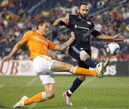 Cam Weaver, Ryan Cochrane Houston Dynamo forward Cam Weaver, left, makes an attempt at goal as New England Revolution defender Ryan Cochrane, right, defends during an MLS soccer game in Foxborough, Mass