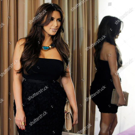 Kim Kardashian Kim Kardashian is reflected in a mirror as she poses at the Noon by Noor launch event in West Hollywood, Calif., . Noon by Noor is a fashion collection designed by Kingdom of Bahrain royalty Noor Rashid Al Khalifa and Haya Mohammed Al Khalifa