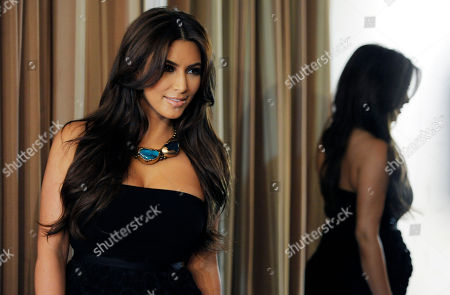 Stock Picture of Kim Kardashian Kim Kardashian poses at the Noon by Noor launch event in West Hollywood, Calif., . Noon by Noor is a fashion collection designed by Kingdom of Bahrain royalty Noor Rashid Al Khalifa and Haya Mohammed Al Khalifa