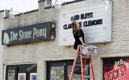 "Jimmy Capo Jimmy Capo, an employee at The Stone Pony, puts a message reading ""God Gless Clarence Clemons"" on the rock bar's marquee in remembrance of saxophonist Clarence Clemons, in Asbury Park, N.J. Clemons, a featured performer who played at the rock bar with Bruce Springsteen and the E Street Band, died of complications from a stroke on June 18"