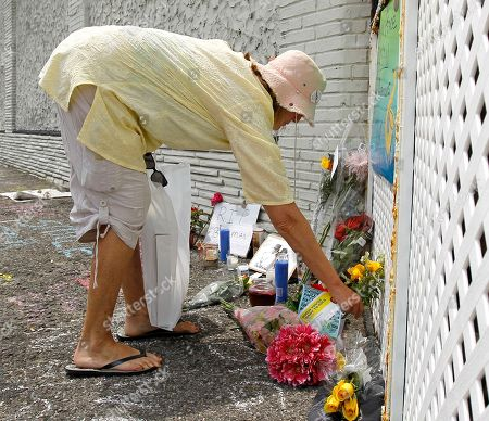 Beverly Jaker Beverly Jaker, of Woodbridge, N.J., places flowers on a memorial for saxophonist Clarence Clemons outside The Stone Pony, in Asbury Park, N.J. Clemons, a featured performer who played at the rock bar with Bruce Springsteen and the E Street Band, died of complications from a stroke on June 18