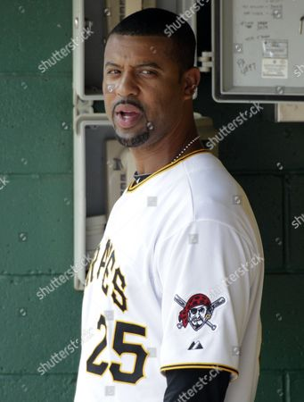 Derrek Lee Pittsburgh Pirates' Derrek Lee (25) stands in the dugout during the ninth inning of a 7-3 loss to the San Diego Padres during a baseball game in Pittsburgh, . Lee missed his fourth game due to a bruised hand