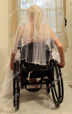 Stock Image of Rachelle Friedman navigates a room in her wheelchair during the fitting for her wedding dress in Raleigh, N.C. Friedman was left paralyzed after a swimming pool accident that postponed her wedding plans. Now, she is all set to commence with those plans