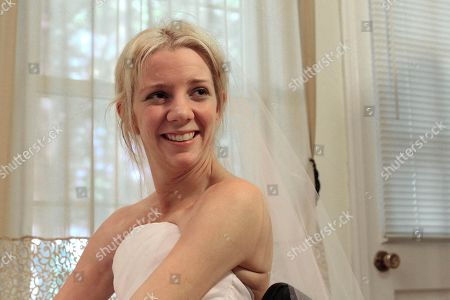 Rachelle Friedman smiles after trying on her wedding dress in Raleigh, N.C. Friedman was left paralyzed after a swimming pool accident that postponed her wedding plans. Now, she is all set to commence with those plans