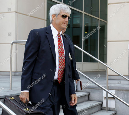 Buju Banton, James Preston Assistant U.S. Attorney James Preston leaves the U.S. Courthouse after a sentencing hearing for Grammy-award winning Jamaican reggae singer Buju Banton in Tampa, Fla., Banton was sentenced to 10-years in prison for conspiring to set up a cocaine deal in 2009