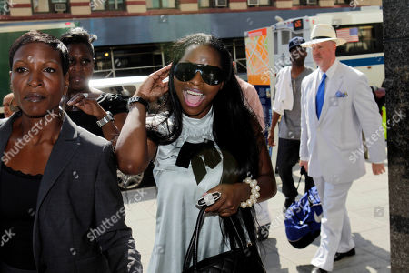 Inga Marchand Inga Marchand, also known as Foxy Brown, center, arrives at court in New York, . A judge on Tuesday dropped charges that rapper Foxy Brown violated a court order by mooning her neighbor