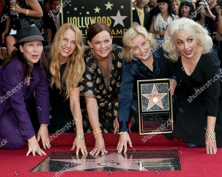 Kathy Valentine, Charlotte Caffey, Belinda Carlisle, Gina Schock, Jane Wiedlin The female band The Go-Go's, from left, Kathy Valentine, Charlotte Caffey, Belinda Carlisle, Gina Schock and Jane Wiedlin are honored with a star on the Hollywood Walk of Fame, in Los Angeles