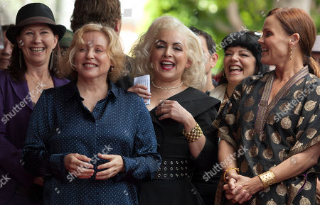 Kathy Valentine, Gina Schock, Jane Wiedlin, Belinda Carlisle The female band The Go-Go's, from left, Kathy Valentine, Gina Schock, Jane Wiedlin and Belinda Carlisle smile before being honored with a star on the Hollywood Walk of Fame, in Los Angeles