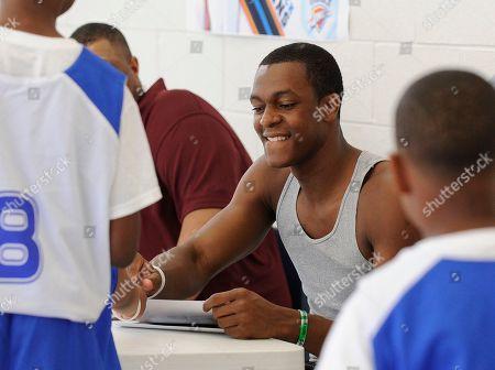 Rajon Rondo Boston Celtics' Rajon Rondo signs autograph at the Kendrick Perkins second annual youth basketball camp, in Beaumont, Texas