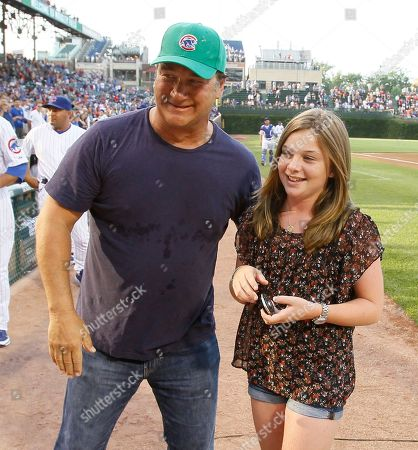 Jamison Belushi, Jamison Belushi Actor Jim Belushi congratulates his daughter Jamison after she sang the national anthem before a baseball game between the Chicago Cubs and the Philadelphia Phillies in Chicago