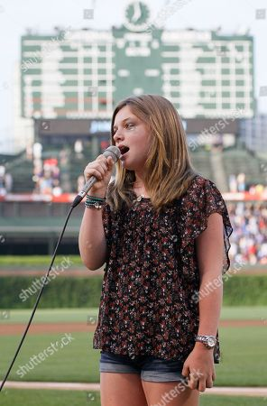 Jamison Belushi Jamison Belushi, daughter of actor Jim Belushi, sings the national anthem before a baseball game between the Chicago Cubs and the Philadelphia Phillies in Chicago