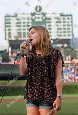 Stock Photo of Jamison Belushi Jamison Belushi, daughter of actor Jim Belushi, sings the national anthem before a baseball game between the Chicago Cubs and the Philadelphia Phillies on in Chicago