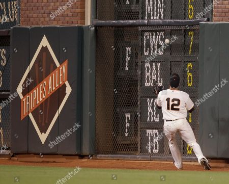 Nate Schierholtz San Francisco Giants right fielder Nate Schierholtz chases a line drive from Pittsburgh Pirates' Derrek Lee during the seventh inning of a baseball game in San Francisco, . Lee got a triple on the play
