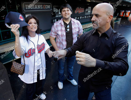 """Valerie Bertinelli, Tom Vitale, Wolfgang Van Halen Actress Valerie Bertinelli, left, of the sitcom """"Hot in Cleveland,"""" hangs out in Cleveland Indians the dugout with her son Wolfgang Van Halen, center, and husband Tom Vitale before throwing a ceremonial first pitch before the Indians face the Pittsburgh Pirates in an interleague baseball game in Cleveland on"""