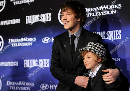 """Connor Jessup, Maxim Knight Connor Jessup, left, and Maxim Knight, cast members in """"Falling Skies,"""" pose together at the premiere screening of the new TNT series in West Hollywood, Calif"""