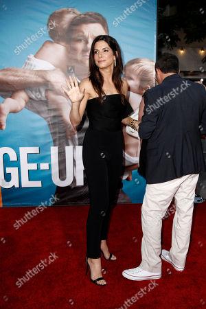"Sandra Bullock, Jonathon Komack Martin Sandra Bullock, left, and executive producer Jonathon Komack Martin arrive at the premiere of ""The Change-Up"" in Los Angeles, . ""The Change-Up"" opens in theaters Aug. 5, 2011"