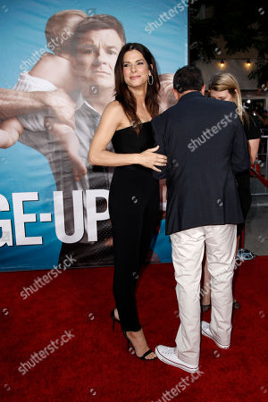 "Sandra Bullock, Jonathon Komack Martin Sandra Bullock, left, and executive producer Jonathon Komack Martin arrive at the premiere of ""The Change-Up"" in Los Angeles, . ""The Change-Up"" opens in theaters Aug. 5, 2011"