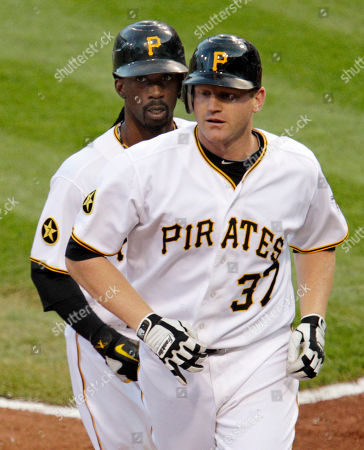 Lyle Overbay, Andrew McCutchen Pittsburgh Pirates' Lyle Overbay (37) heads back to the dugout with Andrew McCutchen after hitting a three-run homer off Boston Red Sox pitcher Tim Wakefield in the fourth inning of an interleague baseball game against the Boston Red Sox in Pittsburgh