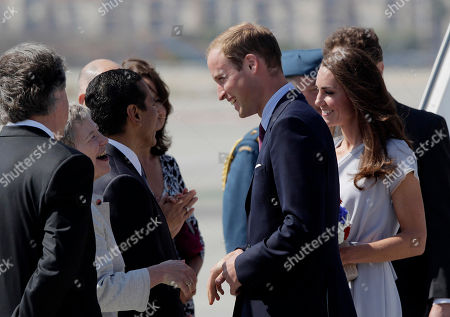 Prince William and Kate, the Duke and Duchess of Cambridge, are greeted by British Consul-General Dame Barbara Hay, second left, as they arrive at Los Angeles International Airport in Los Angeles