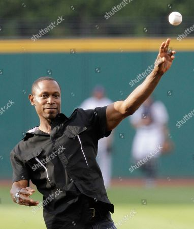 Kenny Lofton Former Cleveland Indians Kenny Lofton throws out the ceremonial first pitch before the Indians play the Kansas City Royals in a baseball game, in Cleveland