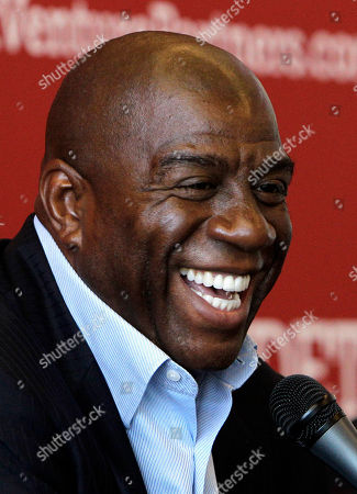 """Earvin Magic Johnson Hall of Fame basketball player turned businessman Earvin """"Magic"""" Johnson smiles during a news conference, in Detroit. Before the death of Don Cornelius stirred pangs of nostalgia in the American public, a group of black entrepreneurs already had begun working to revive Cornelius' creation, Soul Train, and carry it beyond party line dances and television reruns"""