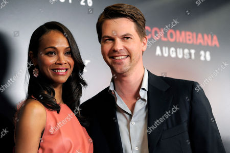 "Stock Image of Zoe Saldana, Keith Britton Zoe Saldana, left, star of the film ""Colombiana,"" poses with her fiance' Keith Britton at a special screening of the film, in West Hollywood, Calif. The film will be released in theaters on Friday"