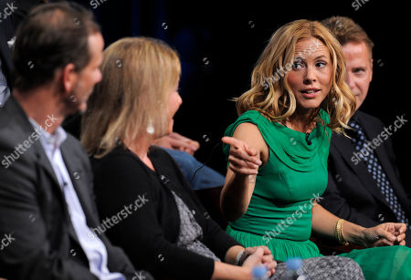"""Maria Bello, Peter Berg, Alexandra Cunningham Maria Bello, right, star of the television series """"Prime Suspect,"""" gestures to executive producer and director Peter Berg, far left, and executive producer and writer, Alexandra Cunningham, during a panel discussion on the show at the NBC Universal summer press tour, in Beverly Hills, Calif"""