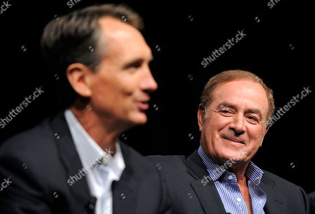 "Al Michaels, Chris Collinsworth Al Michaels, right, play-by-play commentator for ""Sunday Night Football,"" looks over at game analyst Chris Collinsworth as they take part in a panel discussion on the show at the NBC Universal summer press tour, in Beverly Hills, Calif"