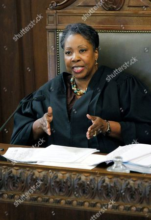 "Tomie Green Hinds County Circuit Judge Tomie Green dismisses a lawsuit by Ablene Cooper against Kathryn Stockett, author of the best-selling novel ""The Help"" in a Hinds County courtroom in Jackson, Miss., The lawsuit was filed by Cooper, who works for Stockett's brother. She claims a main character, Aibileen, is based on her. Cooper accuses Stockett of using her name and likeness without permission. ""The Help"" was made into a movie that opened last week. It's based on relationships between white families and the African-American women who worked for them in the 1960s"