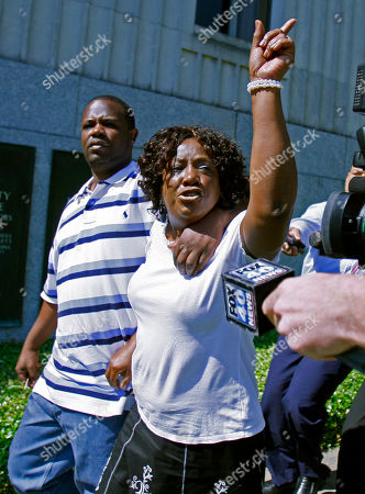 """Ablene Cooper, Antonio Cooper Ablene Cooper, a woman who works for the brother of author Kathryn Stockett, and her son Antonio Cooper, leave the Hinds County Courthouse in Jackson, Miss., expressesing her disappointment that a circuit judge dismissed her lawsuit against the author of """"The Help"""" because a statute of limitations issue. Cooper wants a judge to reinstate a lawsuit that claims Kathryn Stockett, author of the bestselling novel-turned-move """"The Help,"""" used her likeness without permission"""