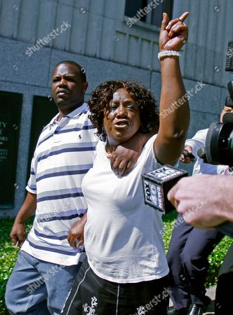 """Ablene Cooper, Antonio Cooper Ablene Cooper, right,and her son Antonio Cooper, leave the Hinds County courtroom in Jackson, Miss., after a circuit judge dismissed her lawsuit against Kathryn Stockett, author of the best-selling novel """"The Help."""" """"The Help"""" was made into a movie that opened last week. It's based on relationships between white families and the African-American women who worked for them in the 1960s. The lawsuit was filed by Cooper, who works for Stockett's brother. She claims a main character, Aibileen, is based on her. Cooper accuses Stockett of using her name and likeness without permission"""