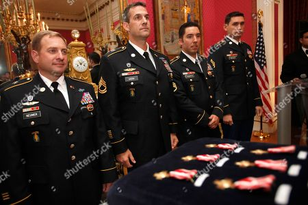 """Stock Photo of David Neumer, Ryan Ahern, Casey Roberts, Ryan Meister Master Sgt. David Neumer, left, Sgt. 1st Class Ryan Ahern, Sgt. 1st Class Casey Roberts, and Sgt. Ryan Meister, 4 of 6 members of the U.S. Special Forces to receive the French """"Croix de la Valeur militaire"""" for distinguished service in Afghanistan alongside the French Taskforce La Fayette, line up before the awards during a ceremony at the Residence of France in Washington, on"""