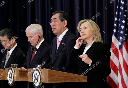 "Takeaki Matsumoto, Toshimi Kitazawa, Hillary Rodham Clinton, Robert Gates From right to left, Secretary of State Hillary Rodham Clinton, Japanese Foreign Minister Takeaki Matsumoto, Defense Secretary Robert Gates, and Japan's Defense Minister Toshimi Kitazawa, pause during a problem with the interpretation as they hold a news conference following the ""2 plus 2"" talks at the State Department in Washington, . Formally known as the United States-Japan Security Consultative Committee meeting, the alliance works to ensure the security of Japan and maintain peace and stability in the Asia-Pacific region"