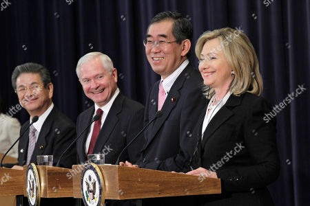 "Takeaki Matsumoto, Toshimi Kitazawa, Hillary Rodham Clinton, Robert Gates From right to left, Secretary of State Hillary Rodham Clinton, Japanese Foreign Minister Takeaki Matsumoto, Defense Secretary Robert Gates, and Japan's Defense Minister Toshimi Kitazawa, smile during a problem with the interpretation as they hold a news conference following the ""2 plus 2"" talks at the State Department in Washington, . Formally known as the United States-Japan Security Consultative Committee meeting, the alliance works to ensure the security of Japan and maintain peace and stability in the Asia-Pacific region"
