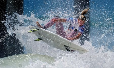 Lakey Peterson Lakey Peterson surfs during the women's finals of the Nike US Open Surfing championship competition, in Huntington Beach, Calif. Peterson took second place in the event