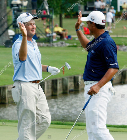 """Hunter Haas, Tom Pernice Jr Hunter Haas, left, receives a congratulatory """"high five"""" from Tom Pernice Jr. after Haas' eagle on the 18th hole during the final round of the Viking Classic PGA golf tournament, in Madison, Miss. Haas finished the tournament in a tie for fourth while Pernice finished in a tie for second"""