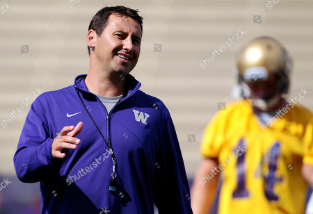 Steve Sarkisian, Thomas Vincent Washington coach Steve Sarkisian, left, directs his players as quarterback Thomas Vincent listens at the team's NCAA college football practice, in Seattle