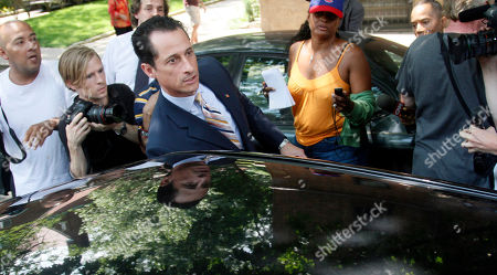U.S. Rep. Anthony Weiner, D-N.Y., his leaves his home for a press conference, in Queens, New York. Weiner has decided to resign his seat in Congress after a two-week scandal spawned by lewd and even x-rated photos the New York lawmaker took of himself and sent online to numerous women