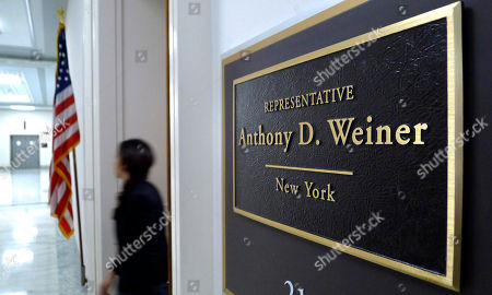 A congressional staff worker leaves the office of departing Rep. Anthony Weiner, D-NY, on Capitol Hill in Washington, . Weiner announced his resignation last week following revelations that he sent text messages containing sexually suggestive photos of himself to young women