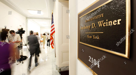 Capitol visitors and staff walk by the office of Rep. Anthony Weiner, D-N.Y. on Capitol Hill in Washington