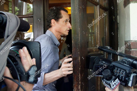 U.S. Rep. Anthony Weiner, D-N.Y., arrives at his home in Queens, N.Y., before leaving for a news conference on . Weiner has decided to resign his seat in Congress after a two-week scandal spawned by lewd and even x-rated photos the New York lawmaker took of himself and sent online to numerous women