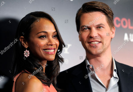 "Zoe Saldana, Keith Britton Zoe Saldana, left, star of the film ""Colombiana,"" poses with her fiance' Keith Britton at a special screening of the film, in West Hollywood, Calif. The film will be released in theaters on Friday"