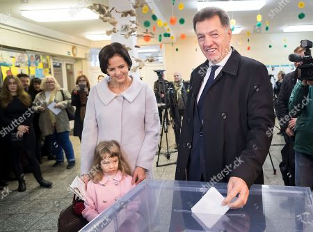 Algirdas Butkevicius, Janina Butkeviciene Lithuania's Social Democrat party leader and Prime Minister Algirdas Butkevicius, right, accompanied by his wife Janina, left, and their granddaughter Kamila, votes at a polling station during parliamentary elections in Vilnius, Lithuania, . Lithuanians are voting in the first round of a parliamentary election, with the governing Social Democrats facing challenges from conservatives and an agrarian party