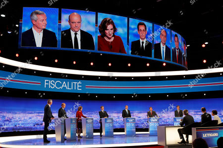 Candidates for France's conservative presidential primary next month from left, French Agriculture minister Bruno Le Maire, French former prime minister Alain Juppe, French politician Nathalie Kosciusko-Morizet, former French President Nicolas Sarkozy, French politician Jean-Francois Cope, head of the French Christian democratic party Jean-Frederic Poisson and former prime minister and French former prime minister Francois Fillon pose prior to a TV debate in Saint Denis, outside Paris