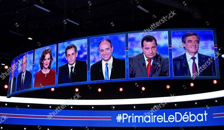 Candidates for France's conservative presidential primary next month from left, French Agriculture minister Bruno Le Maire, French former prime minister Alain Juppe, French politician Nathalie Kosciusko-Morizet, former French President Nicolas Sarkozy, French politician Jean-Francois Cope, head of the French Christian democratic party Jean-Frederic Poisson and former prime minister and French former prime minister Francois Fillon are seen on screens prior to a TV debate in Saint Denis, outside Paris, . The rivalry is heating up between the two top contenders for France's conservative presidential primary next month, with the brash Nicolas Sarkozy and the reassuring Alain Juppe dueling over their visions of France's national identity, immigration and Islam