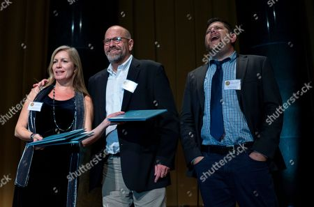 From left, Loenora LaPeter Anton, Michael Braga and Anthony Cormier, all with Tampa Bay Times and Sarasota Herald-Tribune, are recognized for their Pulitzer Prize in Investigative Reporting during the centennial dinner of the Pulitzer Prize awards at Columbia University in New York