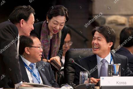 Yoshikatsu Nakayama, Kim Jong-hoon Japan's vice minister for economy, trade and industry, Yoshikatsu Nakayama, far left, and an unidentified Japanese trade official, third from left, greet Korean minister for trade Kim Jong-hoon, second from left, and an unidentified Korean trade official, during the APEC 2011 senior officials meeting, in Big Sky, Mont
